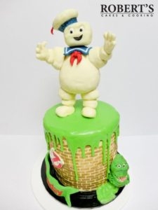 Ghostbusters cake | Ghostbusters cake I made for my best mate's birthday. Slimer and the Staypuft marshmallow man were made with homemade modelling chocolate and Rice Krispy treats, Kellogs LCMs. | https://robertscakesandcooking.com/ghostbusters-cake/